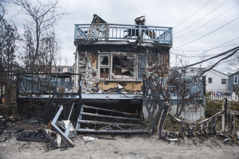 Scenes of destruction caused by Hurricane Sandy in Breezy Point, New York where a fire destroyed 110 homes