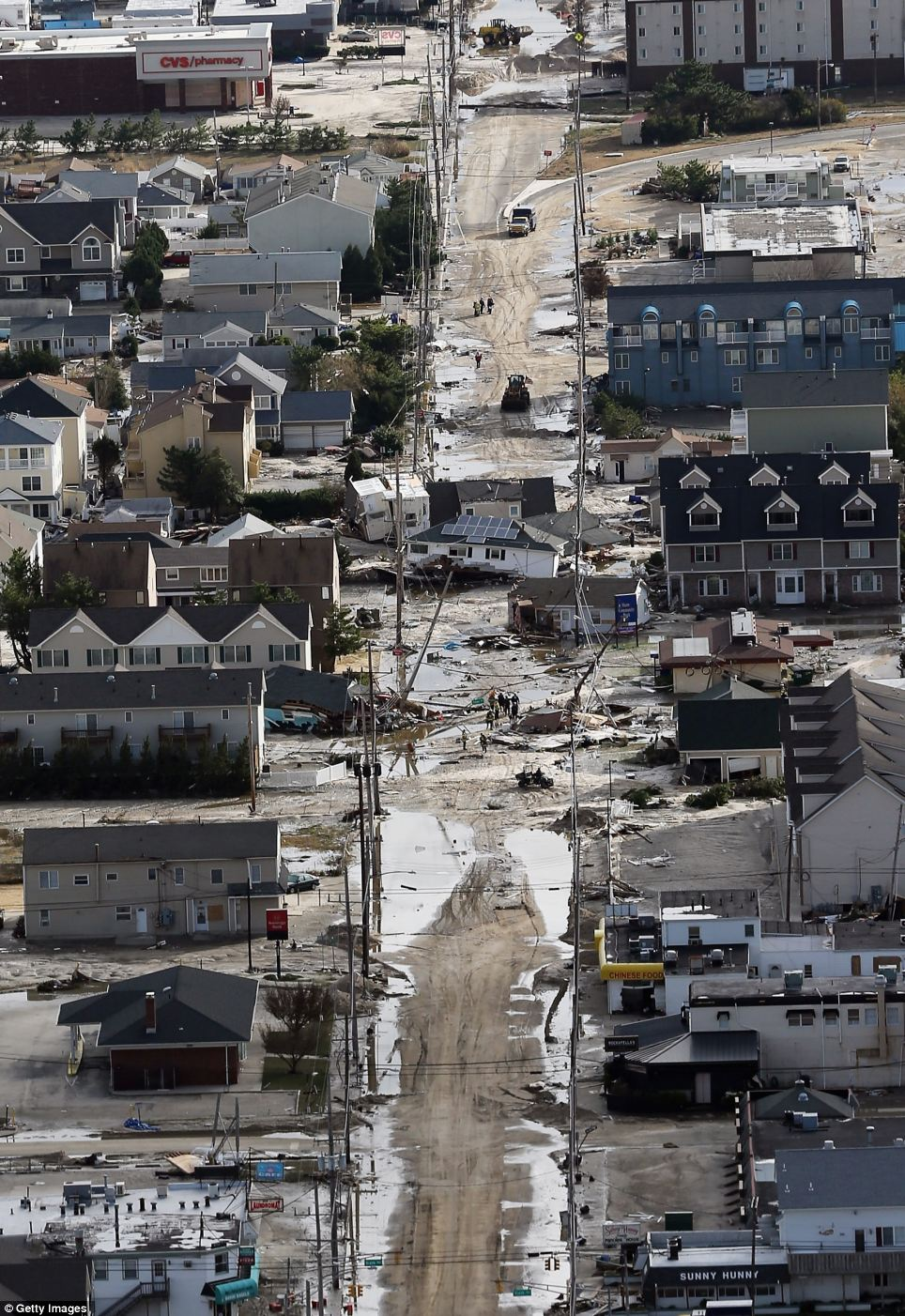 Destroyed homes wrecked by Superstorm Sandy sits in the middle of a street in Seaside Heights, New Jersey