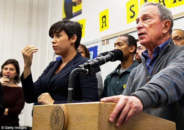 Quietly brilliant: For many, interpreter Lydia Callis (left) has been the best thing about Mayor Michael Bloomberg's Hurricane Sandy briefings