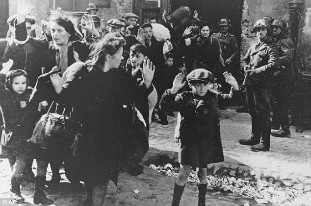 Warmongers: This photo, taken on April 19, 1943, shows a group of Jews, including a small boy, being wscorted from the Warsaw Ghetto by German soldiers