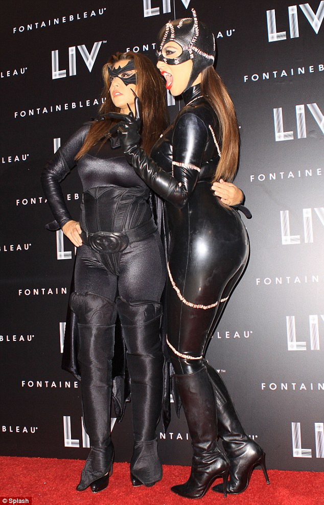 Double trouble: Kourtney and Kim lap up the attention on the red carpet after arriving to the event