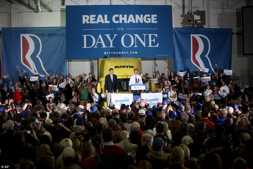 Real change on Day One: Mitt Romney tries to get his message across at a campaign event at a window and door factory in Roanoke, Virginia