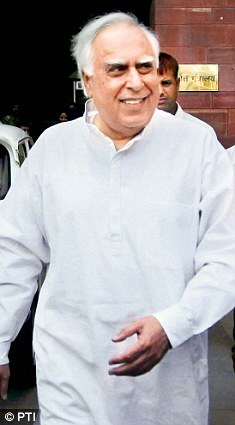 Union Minister Kapil Sibal leaves after attending a meeting