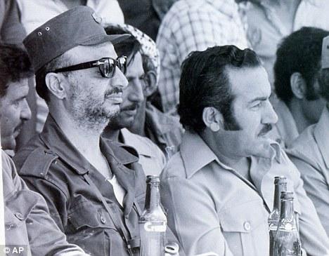 Palestinian leader Yasser Arafat, left, along with his Deputy Abu Jihad, right