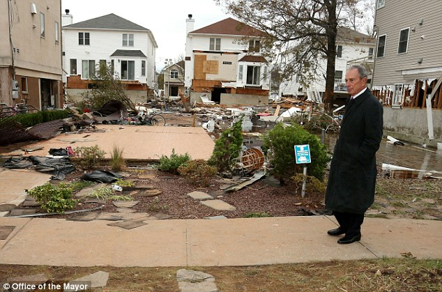 Marathon material? Mayor Michael Bloomberg tours a storm damaged area of Tottenville in Staten Island
