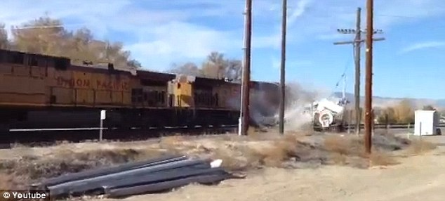 The train smashes into the truck