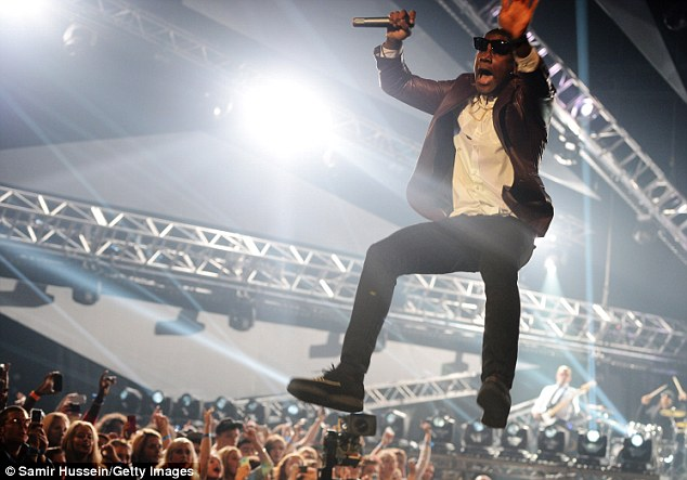 Everybody jump: Labrinth made a spectacular dive across the stage as he performed during the gala