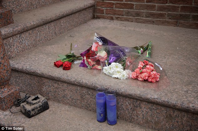 Tribute left outside the home in Staten Island, New York of John K Filipowicz and son John C Filipowicz who drowned in the basement during a flood caused by Superstorm Sandy.