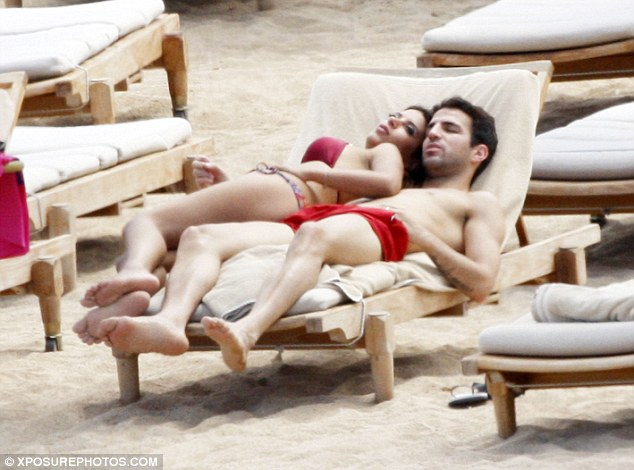 'He stole her from me': Her ex-husband only found out about the relationship after he spotted her picture in the newspaper while on holiday with Fabregas
