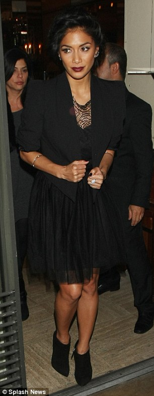 A vision in black: Despite her worried facial expressions, Nicole looked stylish in a pretty black dress