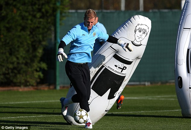 On the move: Joe Hart dribbling through plastic 'defenders'
