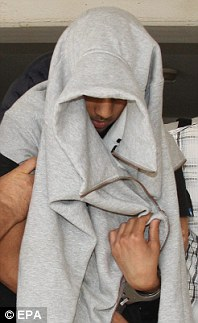 MUSLIM MURDERER OF BRITISH SOLDIER IN CYPRUS The three suspects escorted into a court in the town of Paralimni in Cyprus