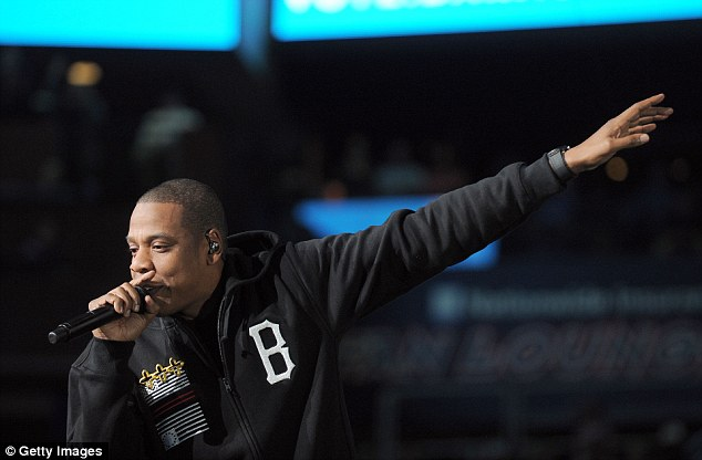 Hip hop royalty: Jay-Z performed at the rally and changed changed the lyrics of the song to include the name Mitt