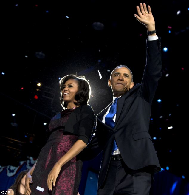 Thank you: President Barack Obama and first lady Michelle entered the stage in Chicago to deafening cheers and applauds