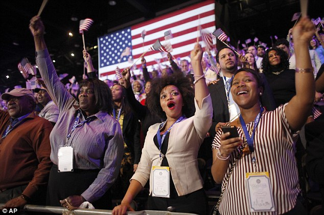 Jubilation: Obama supporters wave their American flags wildly as the President is returned for a second term