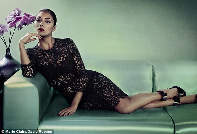 Glamorous: Nicole Scherzinger poses in a black lace dress as she talks about her romance with Lewis Hamilton