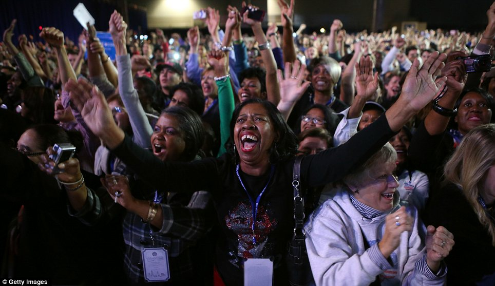 Success: Obama supporters explode with delight as their candidate comes closer to victory