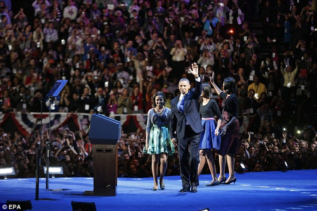 Cheers: Obama and family were met with cheering at McCormick Place in Chicago