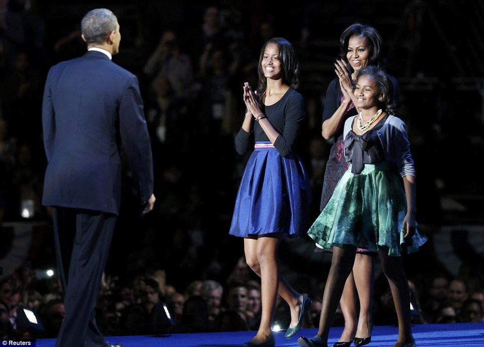 Success: Obama is applauded by his proud family after his victory