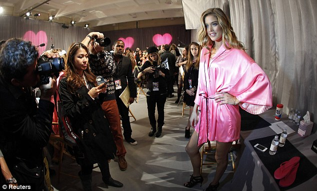 All covered up: Doutzen hid her bottom away beneath a robe before the show got started