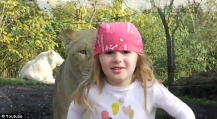 Running scared: The little girl in a pin bandana scampered away with a nervous smile on her rosy-cheeked face