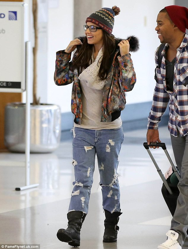 Cute couple: Last Friday Cheryl arrived in Los Angeles with her boyfriend Tre. The singer was sporting a dressed down look for her travels compared with Thursday's chic outfit
