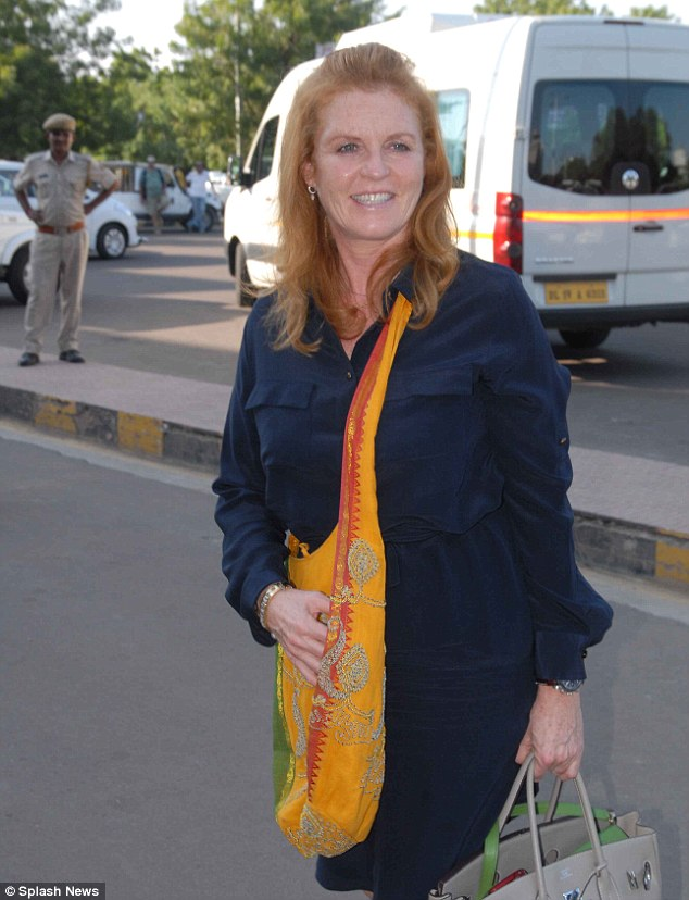 Packed up and ready to go: Sarah Ferguson had a big grin on her face, showing she'd clearly enjoyed herself at the party
