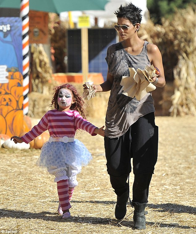 Fighting for a move to France: Halle, seen with Nahla last week, was arguing it would be better for her daughter to grow up away from the glare of the paparazzi