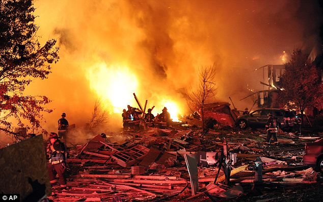 Authorities say a loud explosion has leveled a home in Indianapolis and set four others ablaze in a neighborhood, causing several injuries