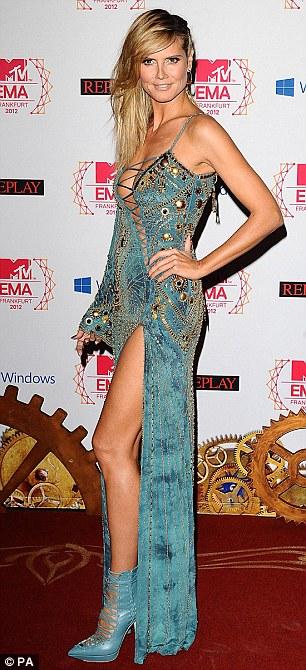 Leggy: The risque Versace creation showed off Heidi's supermodel figure