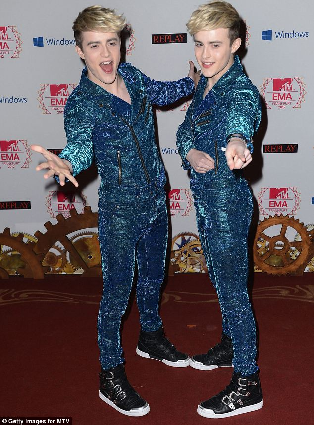 Electric: Jedward wore matching shinny blue suits with their trademark hi-top trainers
