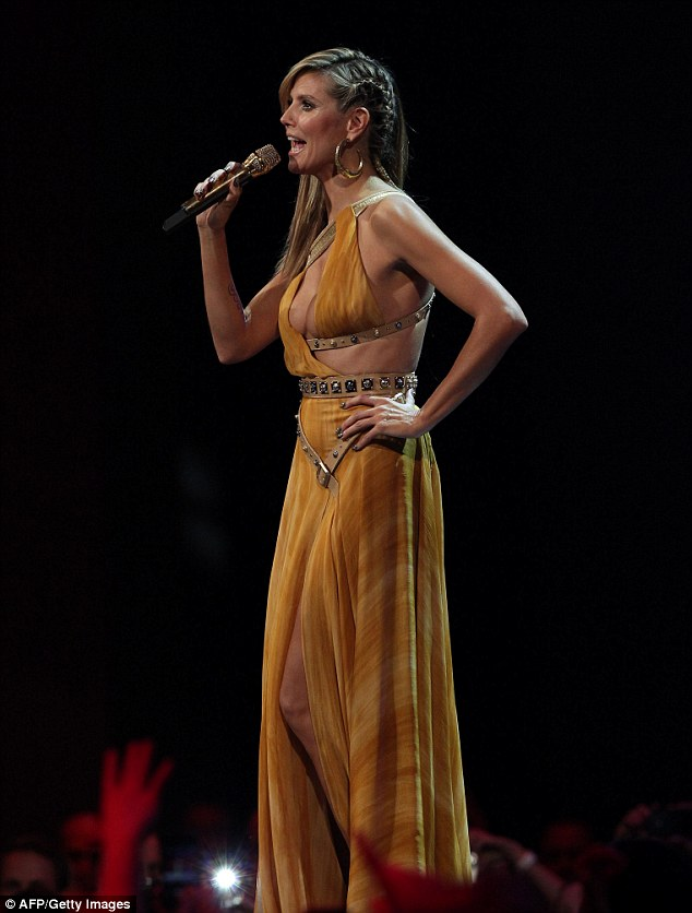 Another change: The supermodel switches her blue gown for a similar one in yellow