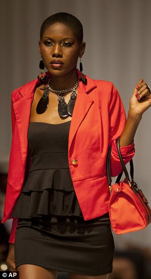 A model wears a creation by Haitian designer Sybille Denis Touat during Fashion Week in Port-au-Prince, Haiti
