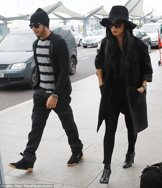 Quality time: They looked like they couldn't wait to get on their flight ahead of Hamilton's US Grand Prix at the weekend