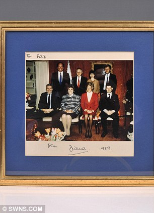 The Prince and Princess of Wales - signed Royal presentation photograph of the Royal couple with their staff on board the Royal Yacht Britannia will be sold