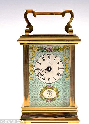 A fine Royal presentation carriage clock, by Halcyon Days Enamels is on offer too