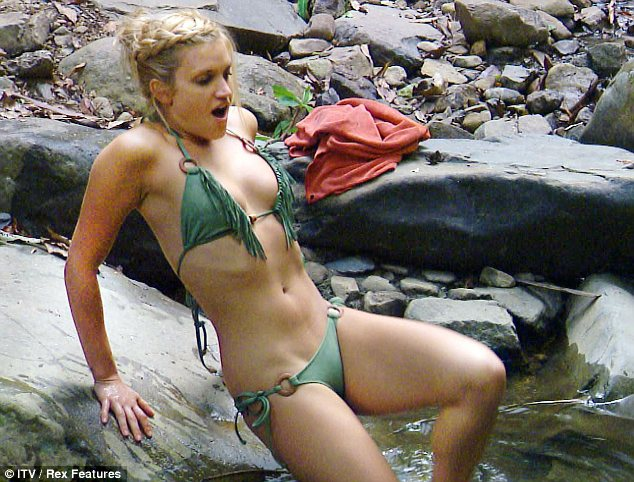 Taking the plunge: Ashley has been getting to grips with jungle life, including the bathing