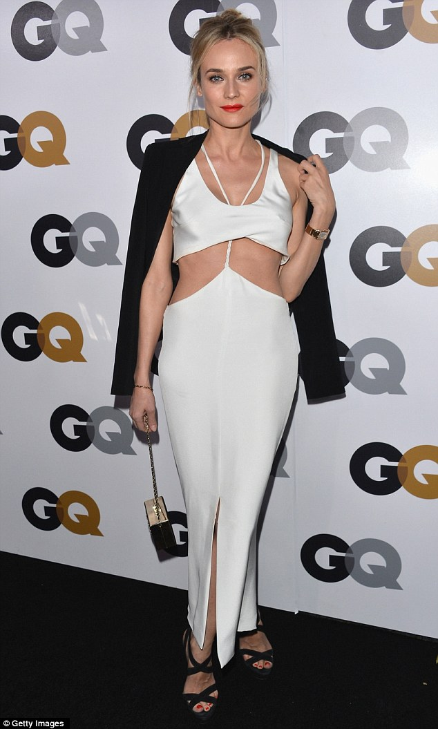 Edgy: Diane Kruger also displayed her midriff in more an unusual cream dress, which was slashed at the middle, yet held together with a braid that looped around her neck