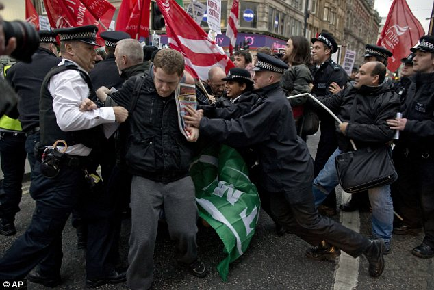 London: Protesters tussle with police on Oxford Street in a demonstration over the dismissals of 28 Crossrail workers being held to coincide with the planned anti-austerity strikes happening across Europe today