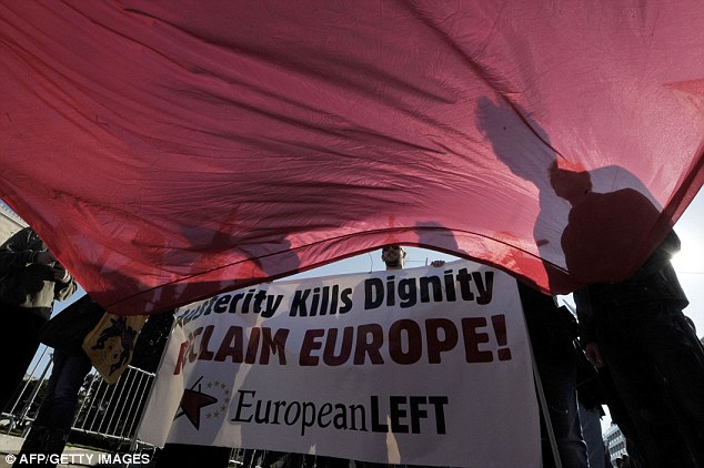 Greece: A banner proclaims: 'Austerity kills dignity - reclaim Europe' during a protest outside the Greek parliament in Athens
