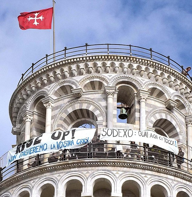 Leaning to the left: A banner reading: 'Rise Up! We don't pay your crisis' is unfolded by protesting students at the top of the leaning tower of Pisa
