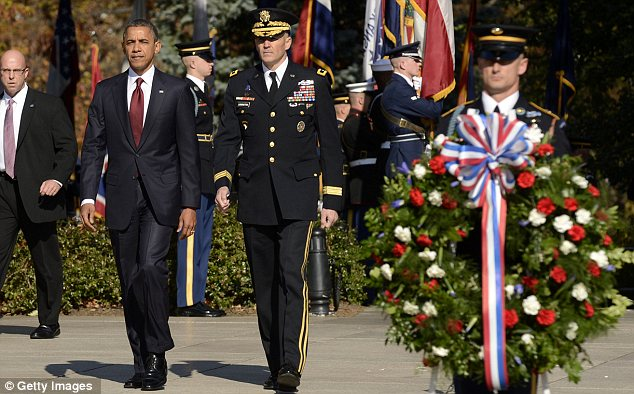 Plot: Court papers say Kusick wanted to be known as 'the guy who killed President Obama,' pictured on Sunday at a wreath-laying ceremony at the Tomb of the Unknowns at Arlington National Cemetery