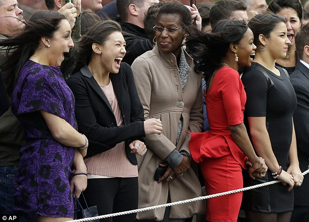 South Lawn: Taking a leaf out of McKayla's book, Aly (far right) looked decidedly unimpressed as a gust of wind blew Jordan, Kyla and Gabby backward