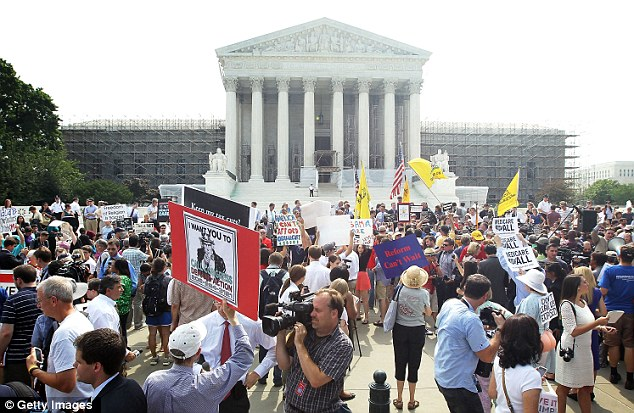 Obamacare supporters and protesters gather in front of the U.S. Supreme Court to find out the ruling on the Affordable Health Act June 28, 2012 - the Court upheld the controversial legislation