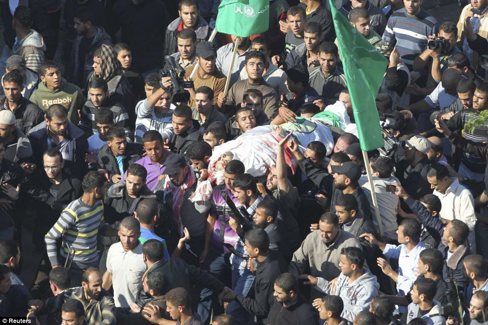 Commeration: Palestinians carry the body of Ahmed Al-Jaabari, top commander of Hamas armed wing Izz el-Deen Al-Qassam, during his funeral