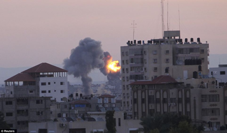 Destruction: Overnight, the military said it targeted about 150 of the sites Gaza gunmen use to fire rockets at Israel, as well as ammunition warehouses, bringing to 450 the number of sites struck since the operation began Wednesday