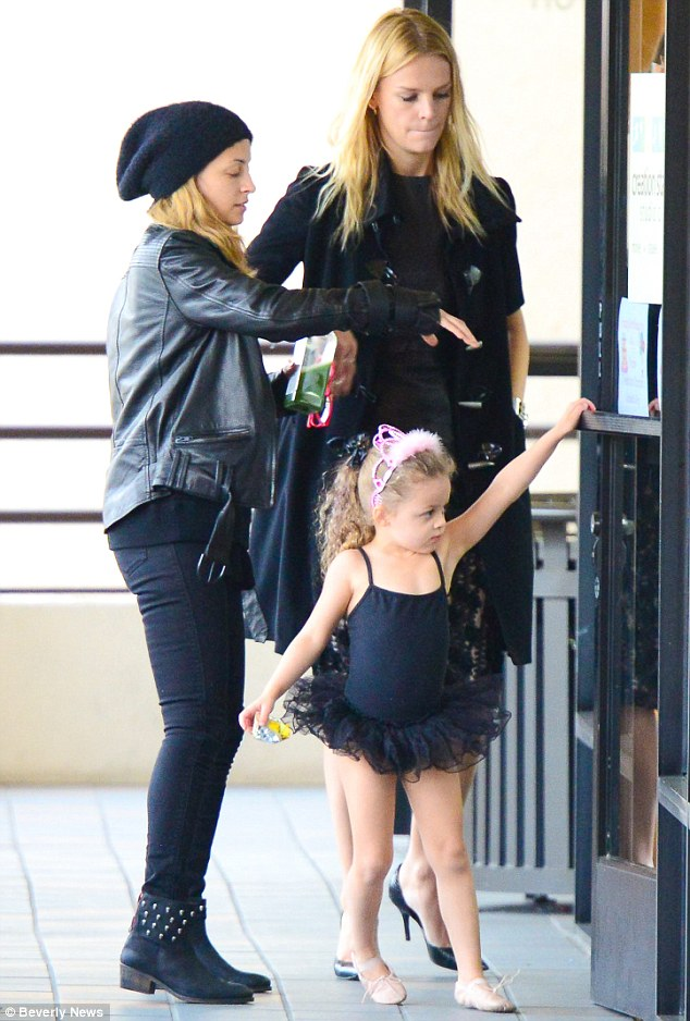 Showing off her moves: Harlow stretched up in her black leotard and tutu as she eagerly made her way to class