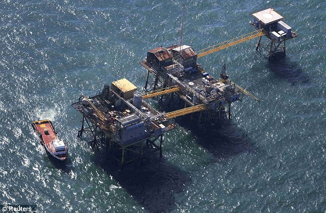 Quick response: Rescue crew surrounds an oil platform which exploded early this morning in the Gulf of Mexico, off the coast of Louisiana
