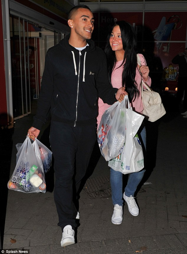 The look of love: Tulisa looked completely smitten as she gazed at Danny Simpson when leaving a Tesco in Newcastle on Wednesday evening