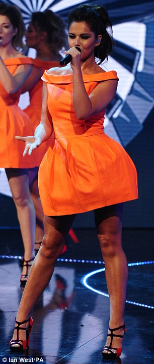 Getting into the groove: Cheryl Cole and Sarah Harding threw themselves into their performance